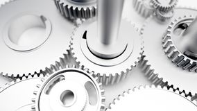 stock image of  dented steel glossy gears industrial cogs