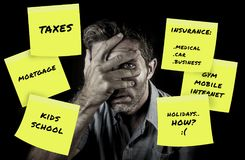 stock image of  desperate and frustrated family man covering eyes scared after domestic accounting worried about money and taxes calculating expen