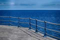 stock image of  detail of sea wall roped barrier