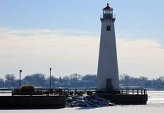 stock image of  detroit riverfront lighthouse during cold winter facing canada