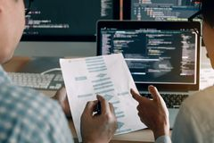 stock image of  developing programming and coding technologies working in a software engineers developing applications together in office