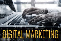 stock image of  digital marketing concepts ideas with male hand using laptop and chart interface