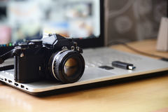 stock image of  digital studio photography workstation. retro film dslr camera,