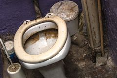 stock image of  dirty unhygienic toilet bowl with limescale stain at public restroom