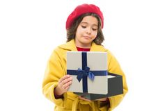 stock image of  disappointing purchase. child stylish hold open gift box. girl cute little lady coat and beret throws out gift. spring