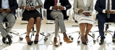 stock image of  diverse business people use digital devices