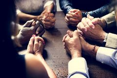 stock image of  diverse group of christian people praying together