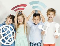 stock image of  diverse kids with internet icons