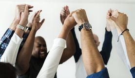 stock image of  diverse people joining hands together success and celebration concept