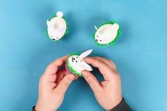 stock image of  diy rabbit from easter eggs on blue background. gift ideas, decor easter, spring. handmade