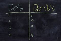 stock image of  do`s or don`ts written with color chalk concept on the blackboard