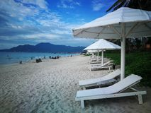 stock image of  doclet beach doc let in nha trang vietnam. seaside. white sunbeds and umbrellas by the sea
