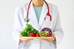 stock image of  doctor holding fresh fruit and vegetable, healthy diet.