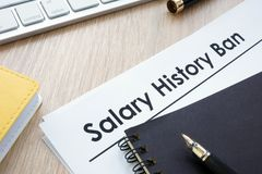 stock image of  documents with title salary history ban.