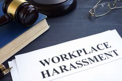 stock image of  documents about workplace harassment in a court.