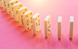 stock image of  domino row on pink