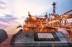 stock image of  double exposure of hand control automate contol panel with oil a