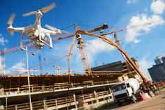 stock image of  drone over construction site. video surveillance or industrial inspection