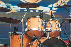 stock image of  drum kit on stage lights performance. live music. festival and s