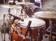 stock image of  drum set with microphone band live concert entertainment event