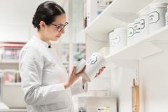 stock image of  pharmacist checking a chemical pharmaceutical substance