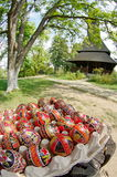 stock image of  easter. hand painted eggs and traditional orthodox wooden church barsana monastery - landmark attraction in maramures, romania