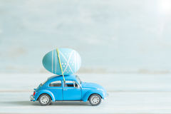 stock image of  easter egg on the car concept in retro mood