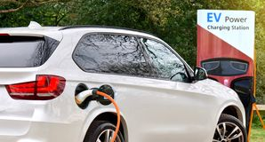 stock image of  electric car & x28;ev& x29; at charging battery at ev charge station with the power cable supply plugged