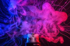 stock image of  electronic cigarette vape explosion. cloud of vapor
