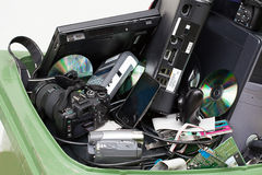 stock image of  electronics in dustbin