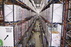 stock image of  elevated view of aisle between storage units in a warehouse