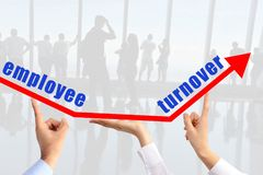 stock image of  employee turnover concept, with human hands sustaining an arrow