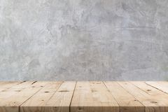 stock image of  empty wooden table and concrete wall texture and background with copy space, display montage for product