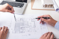 stock image of  engineering or creative architect in construction project, engineers hands working with compasses on construction blueprint build