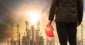 stock image of  engineering man with safety helmet standing in industry estate a