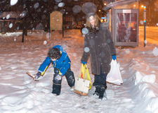 stock image of  everyday life of a single mother during winter in toronto
