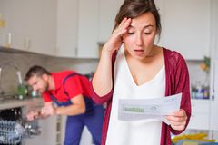 stock image of  expensive appliance repair costs and sad woman