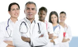 stock image of  expertise doctor multiracial nurse team row
