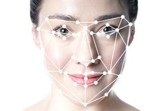 stock image of  face detection or facial recognition grid overlay on face of woman