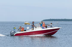 stock image of  families in leisureboat oregrund sweden