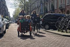 stock image of  families on bikes, amsterdam, holland