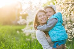 stock image of  family mom with daughter woman with child in spring stand and hug
