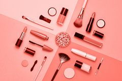 stock image of  fashion cosmetic makeup coral set. beauty flat lay