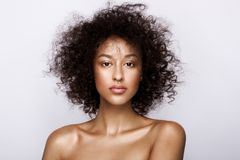 stock image of  fashion studio portrait of beautiful african american woman with perfect smooth glowing mulatto skin, make up