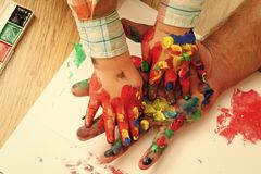 stock image of  fathers day, family love and care. imagination, creativity and freedom. kids playing - happy game. handprint painting