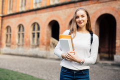 stock image of  female college student. happy girl in european university for scholarship.