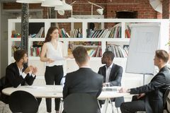 stock image of  female executive coaching group of corporate employees during br