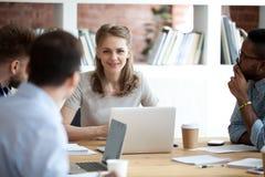 stock image of  female executive leader boss leading corporate multi-ethnic team meeting