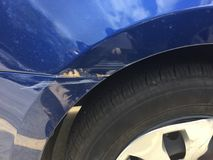 stock image of  fender damage to a car