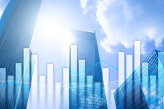 stock image of  financial graphs and charts on blurred business center background. invesment and trading concept